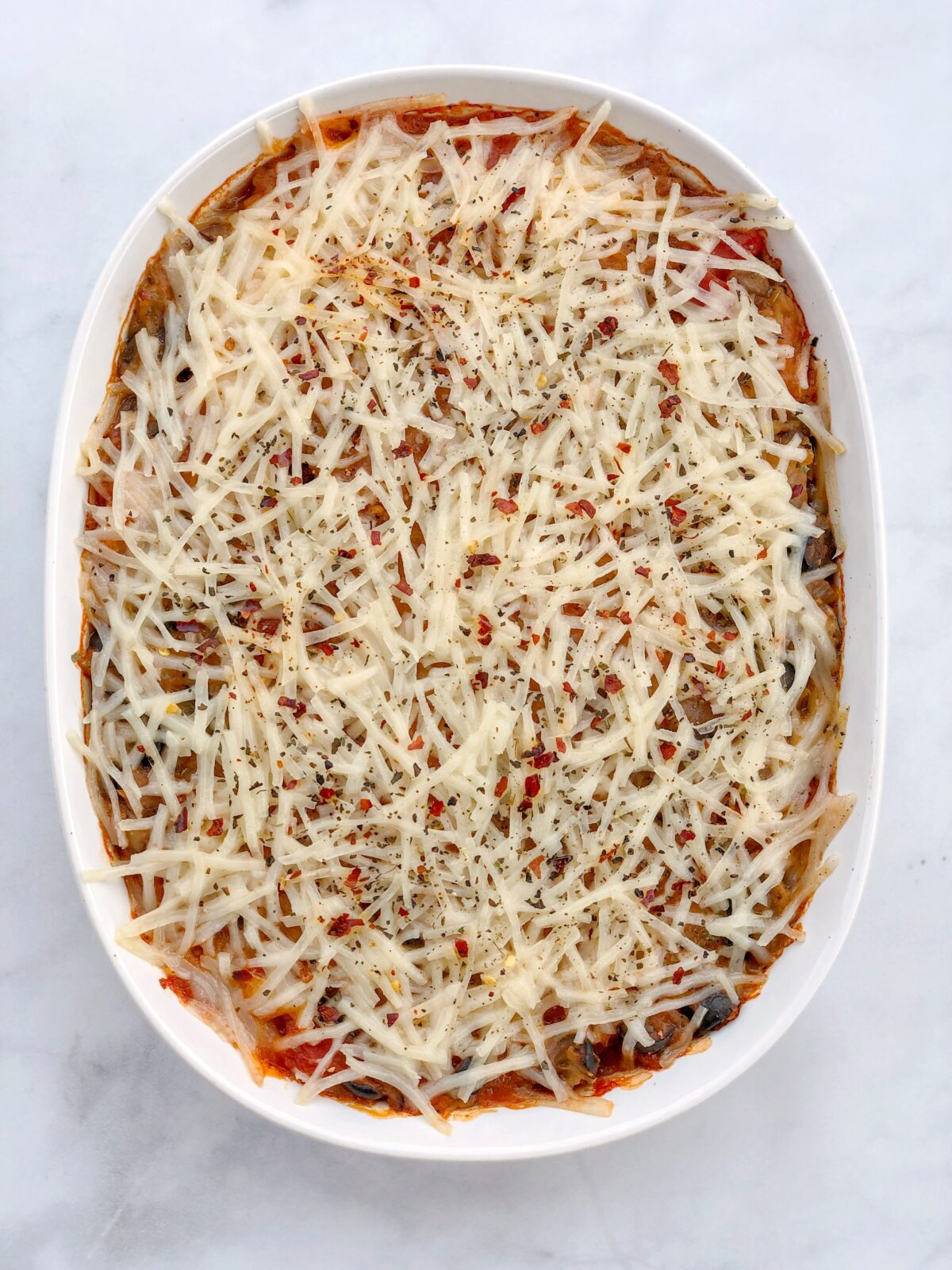 6-Ingredient Spaghetti Squash Pizza Casserole is dairy-free, egg-free, gluten-free and vegan. This dinner casserole is low-carb, hearty, and healthy!