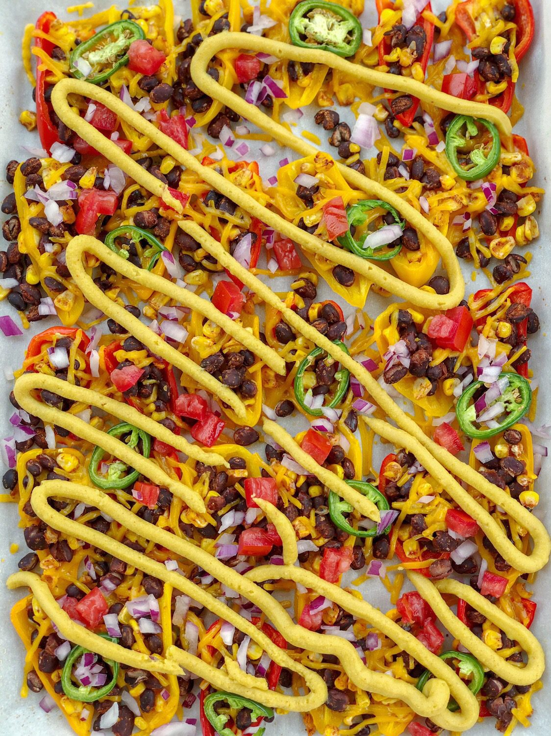 Vegan Mini Sweet Pepper Nachos are the ultimate low-carb, dairy-free, and gluten-free snack sure to please any crowd!