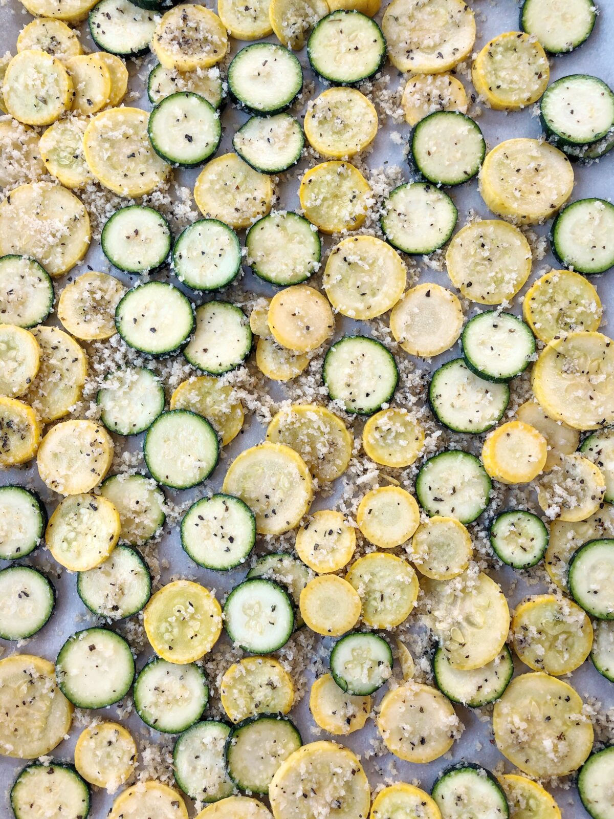 Crispy Baked Zucchini and Squash make a great summer snack or side dish! Combine veggies with Panko, olive oil, salt and pepper, then roast for 30 minutes