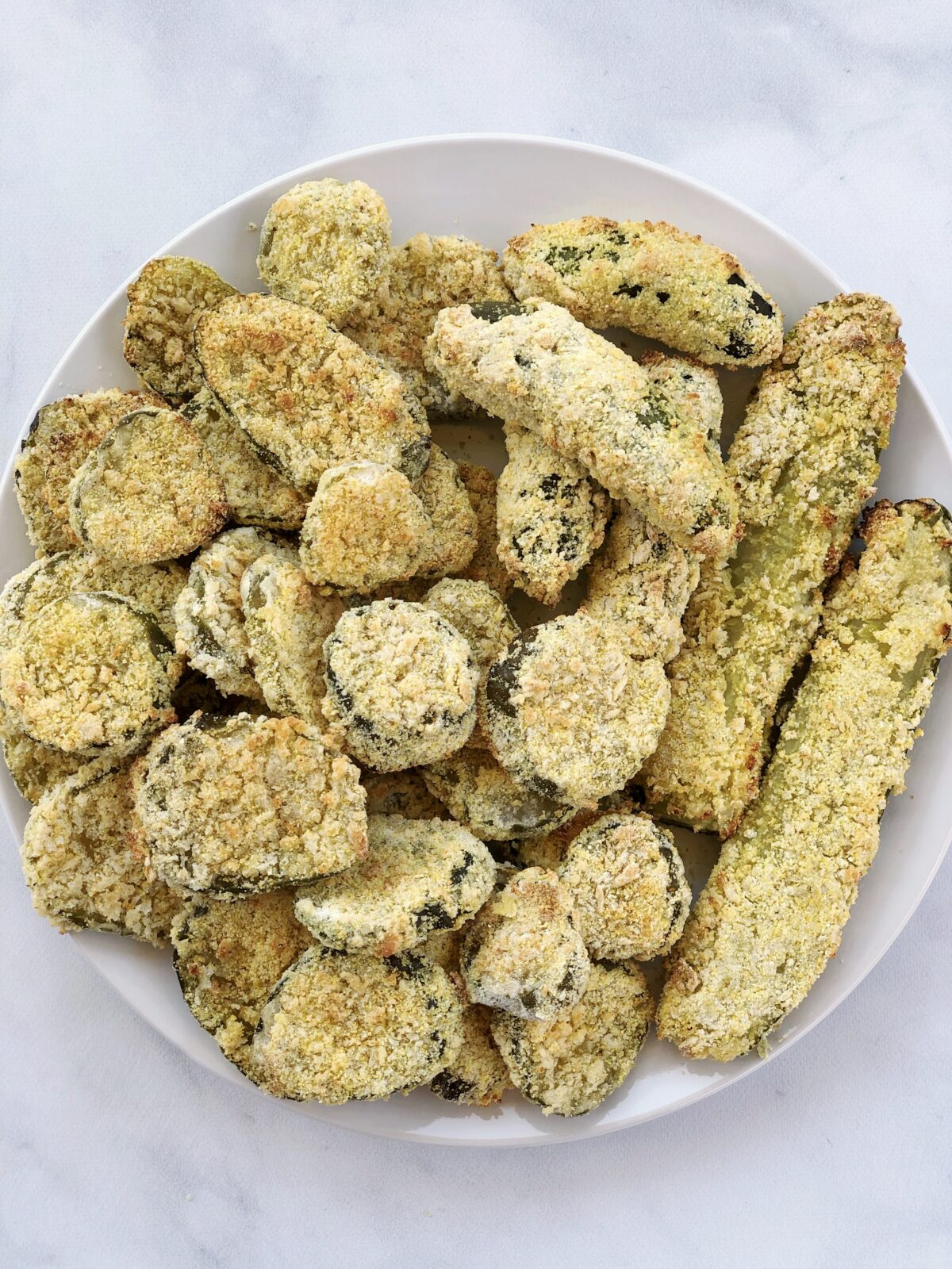 Vegan Air Fryer Fried Pickles are amazingly quick and easy. They are perfectly crisp using less than 10 completely dairy-free and egg-free ingredients