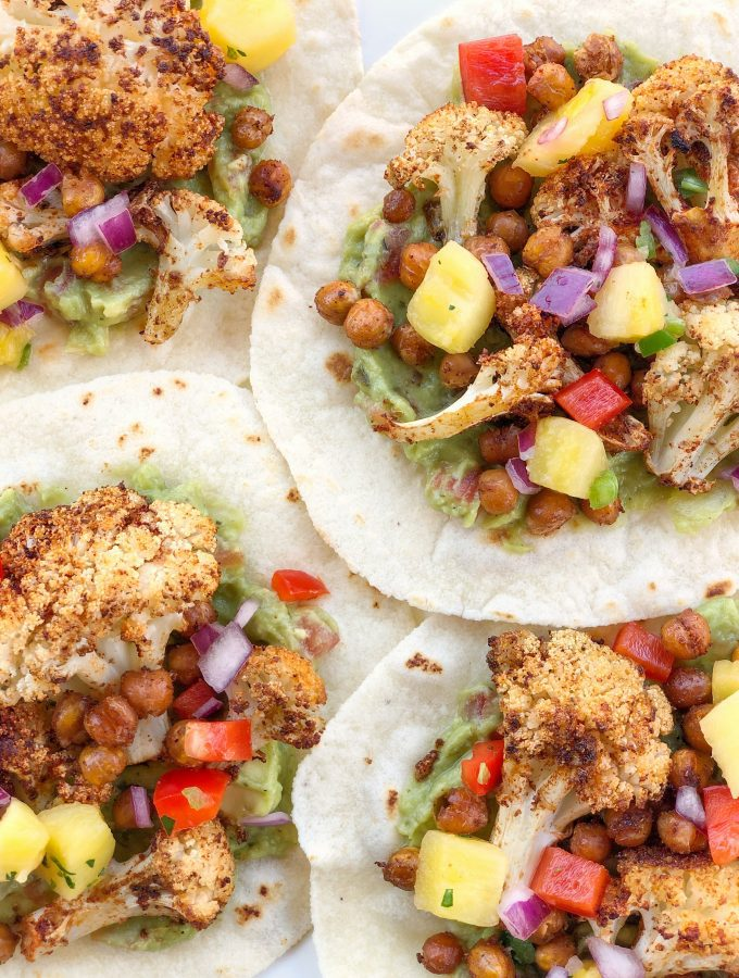 Roasted Cauliflower and Chickpea Tacos with Pineapple Salsa is a healthy and filling meatless meal, perfect for any day of the week.Plant-based, dairy-free, and gluten-free!