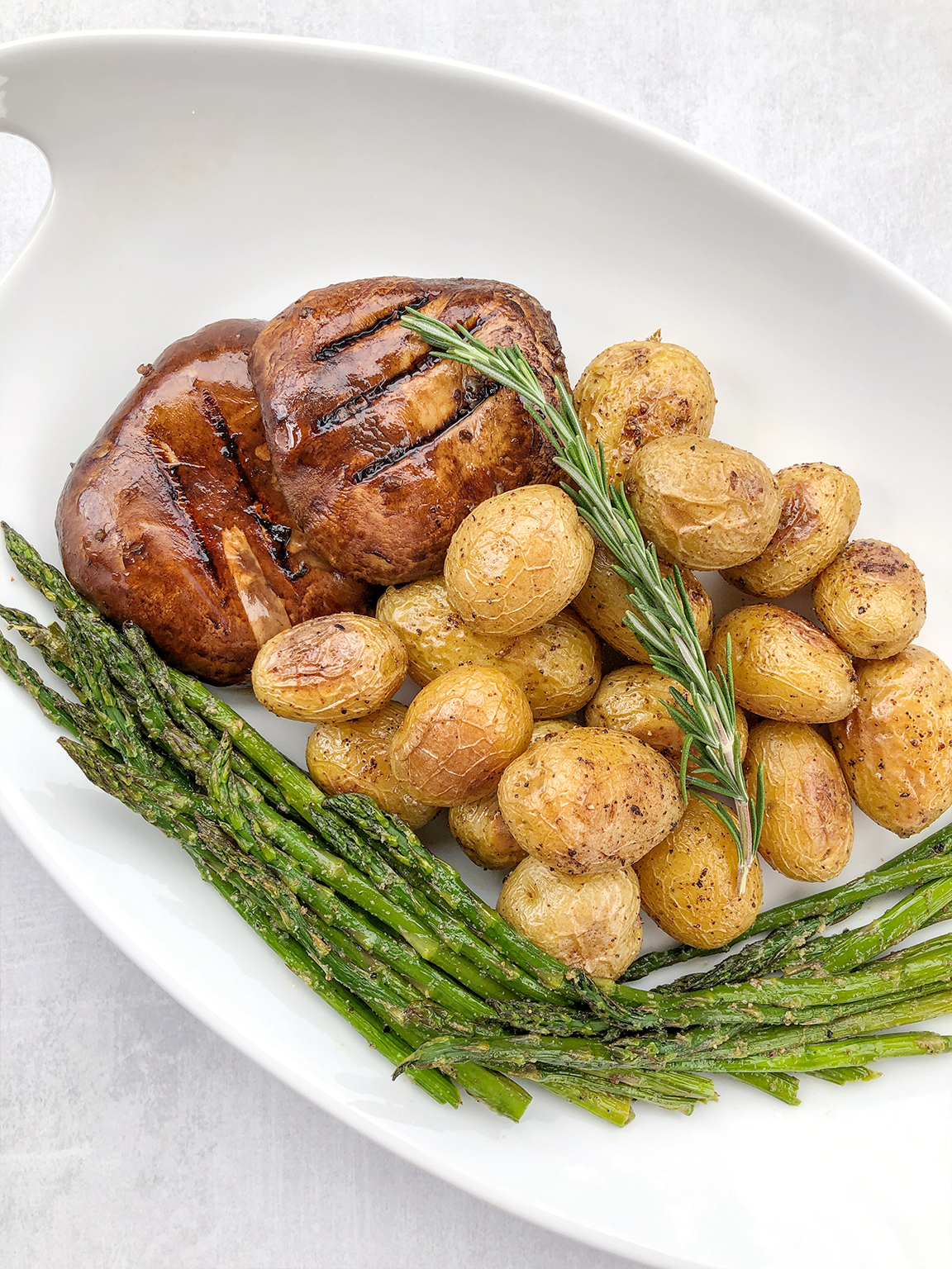 Grilled Portobello Mushroom Steaks with Potatoes and Asparagus